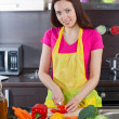 Woman in the kitchen cut vegetables — Stock Photo #26861873