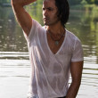 Handsome young man in wet clothes — Stock Photo #28267731