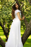 Young woman in a white dress — Stock Photo