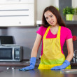 Young woman cleaning kitchen — Stock Photo #38691459