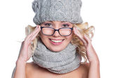 Woman in a hat, scarf and glasses — Stock Photo