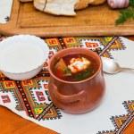 Ukrainian borsch and a bowl of sour cream — Stock Photo #43668039
