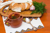 Ukrainian borsch and bread — Stock Photo