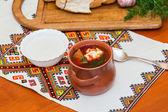 Ukrainian borsch and a bowl of sour cream — Stock Photo