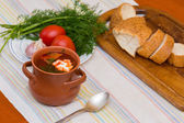 Ukrainian soup and bread with vegetables — Stock Photo
