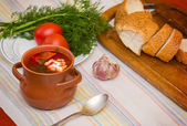Ukrainian soup and bread with vegetables on   — Stock Photo