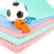Stock Photo: Football and whistle on color napkins