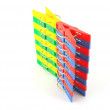 Foto Stock: Color clothes-pegs over white