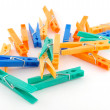 Color clothes-pegs over white — Stock Photo