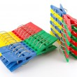 Stock Photo: Color clothes-pegs over white