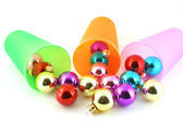 Color christmas decorations (balls) with cups — Stockfoto