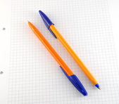 Two pen on the checked paper — Stock Photo