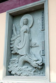 Ваs-relief of stone on the wall of the monastery — Stock Photo