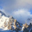 Snow-capped peaks and clouds - Stok fotoraf