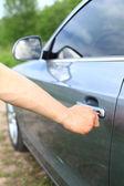 Man unlock car door by key — Stock Photo