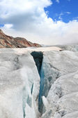Large crevasses with a snow bridge — Stock Photo