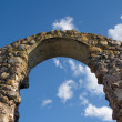 Stock Photo: Ancient arc on blue sky background.