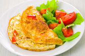 Omelet with vegetable salad — Stock Photo