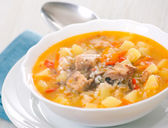 Fish soup with potato and rice — Stock Photo