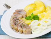 Herring fillet with potatoes and onions — Stock Photo