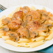 Pasta penne with meatballs and mushroom sauce — Stock Photo