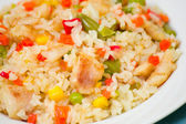 Rice with vegetables and fish — Stock Photo
