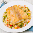 Fish fillet with rice and vegetables — Stock Photo #19701749
