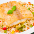 Fish fillet with rice and vegetables — Stock Photo