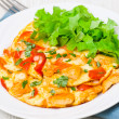Omelette with slices of chicken breast and vegetables — Stock Photo #25101285