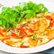 Omelette with slices of chicken breast and vegetables — Stock Photo