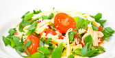 Fresh vegetable salad with cherry tomatoes, green onions and cheese — Stock Photo
