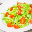 Fresh vegetable salad with cherry tomatoes and cabbage — Stock Photo