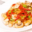 Chicken with sweet peppers and mushrooms — Stock Photo