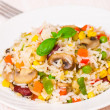 Rice with mushrooms and vegetables — Stock Photo