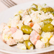 Salad with chicken, ham, potatoes and olives — Stock Photo