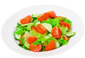 Fresh vegetable salad with lettuce, tomato and cucumber — Stock Photo