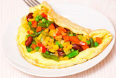 Omelette with vegetable mix — Stock Photo