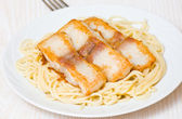 Spaghetti with fish — Stock Photo