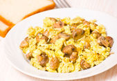 Scrambled eggs with mushrooms — Stock Photo