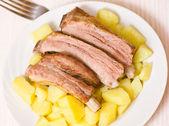 Roasted pork ribs with potatoes — Stock Photo