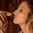 Woman kissed rat — Stock Photo #10598094