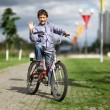 Boy with bike in city street — Stock Photo #12638598