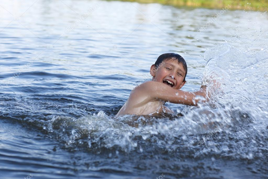 Boy in river with splash  — Stock Photo #12638568