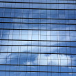 Sky and clouds reflected in windows of modern office building — Stock Photo