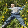 Beautiful funny Boy and dandelion — Stock Photo