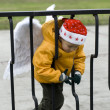 Little boy angel in Christmas hat outdoors — Stock Photo #15405927