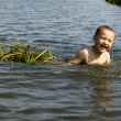 Boy in river — Stock Photo