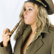 Blonde in old soviet military form with vintage smoker tube — Stock Photo #15408085