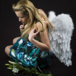 Angel with madonna lily — Stock Photo