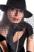 Girl in retro style with veil and gloves — Stock Photo